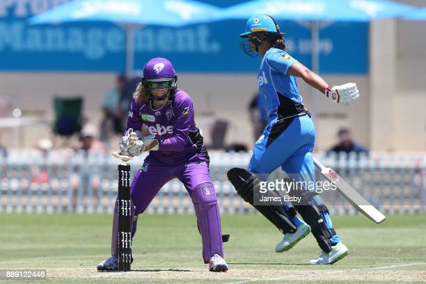 Georgia Redmayne of the Hobart Hurricanes attempts to run out Suzie Bates of the Adelaide Strikers during the Women's Big Bash League WBBL match...