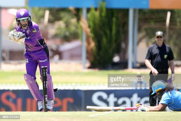 Georgia Redmayne of the Hobart Hurricanes run out Tabatha Seville of the Adelaide Strikers during the Women's Big Bash League WBBL match between the...