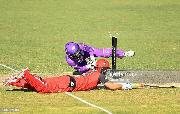 Georgia Redmayne of the Hurricanes attempts to run out Kris Britt of the Renegades during the WBBL match between the Renegades and Hurricanes on...
