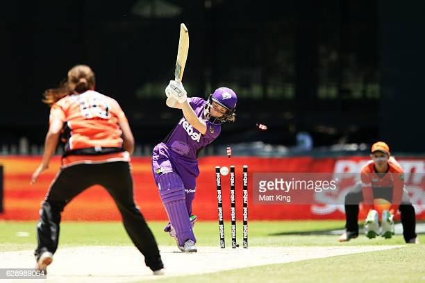Georgia Redmayne of the Hurricanes is bowled by Suzie Bates of the Scorchers during the Women's Big Bash League match between the Perth Scorchers and...