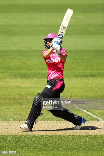 Georgia Redmayne of the Hurricanes watches on as Ellyse Perry of the Sixers bats during the Women's Big Bash League match between the Hobart...