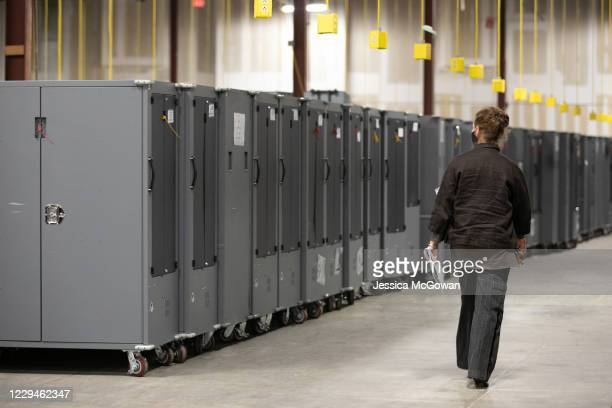 Georgia Republican Party poll watcher looks over voting machine transporters being stored at the Fulton County Election Preparation Center on...