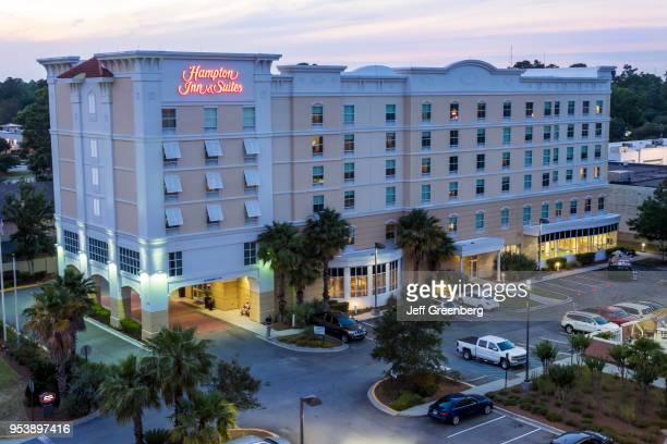 Georgia Savannah Midtown Hampton Inn and Suites hotel exterior aerial at dusk