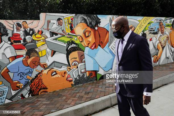 Georgia Senatorial candidate Reverend Raphael Warnock looks at a mural dedicated to Elizabeth Porter who was a local Civil Rights icon, at a...