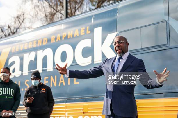 Georgia Senatorial candidate Reverend Raphael Warnock speaks to supporters at a canvassing event on January 5, 2021 in Marietta, Georgia. - Voters...