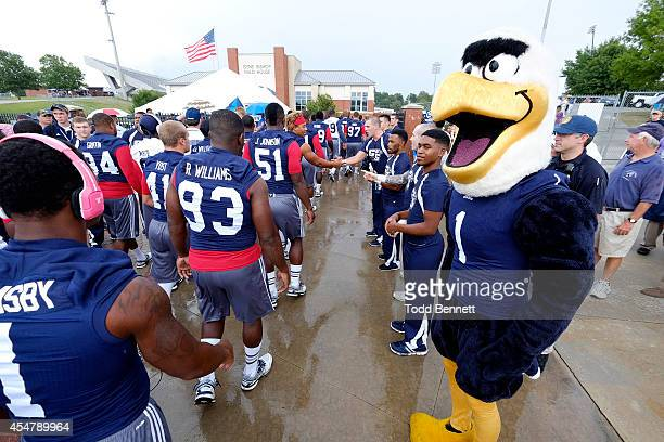 Georgia Southern Eagles players participate in the Eagle Walk prior to the start of Georgia Southern's game against Savannah State Tigers on...