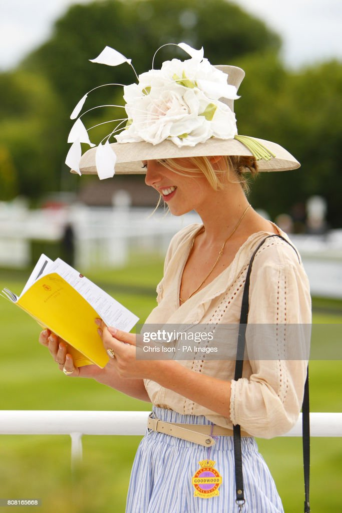 Georgia Spray checks the race card on Ladies' Day during day