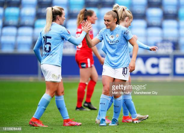 Georgia Stanway and Lauren Hemp of Manchester City celebrate during the Barclays FA Women's Super League match between Manchester City Women and...