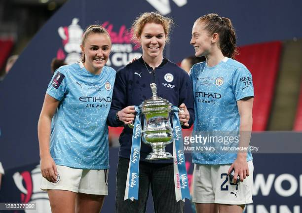 Georgia Stanway, Aoife Mannion and Keira Walsh of Manchester City celebrate with the trophy during the Vitality Women's FA Cup Final match between...