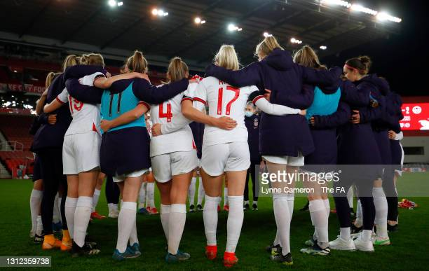 Georgia Stanway, Chloe Kelly of England and teammates form a huddle on the pitch at full-time after the International Friendly match between England...