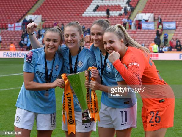 Georgia Stanway Keira Walsh Janine Beckie and Ellie Roebuck celebrate winning the league cup during the FA Women's Continental League Cup Final...