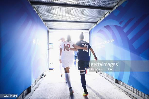 Georgia Stanway of England and Fuka Nagano of Japan walk out of the tunnel for the FIFA U20 Women's World Cup France 2018 Semi Final semi final match...