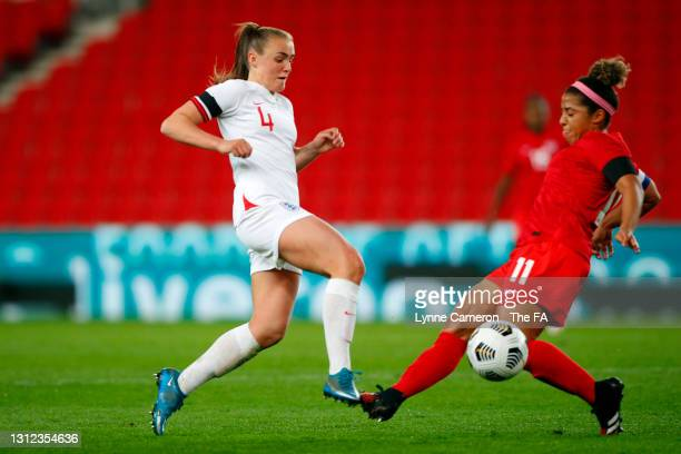 Georgia Stanway of England is tackled by Desiree Scott of Canada during the International Friendly match between England and Canada at Bet365 Stadium...