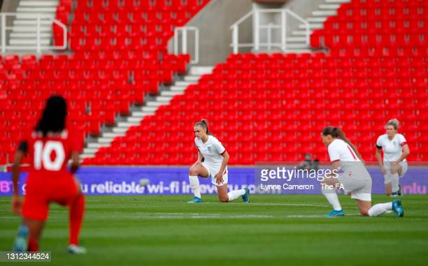 Georgia Stanway of England takes a knee in support of the Black Lives Matter movement prior to the International Friendly match between England and...
