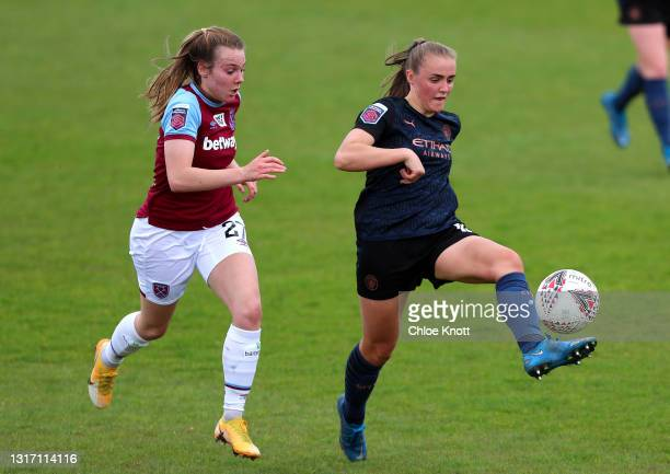 Georgia Stanway of Manchester City controls the ball under pressure from Maisy Barker of West Ham United during the Barclays FA Women's Super League...