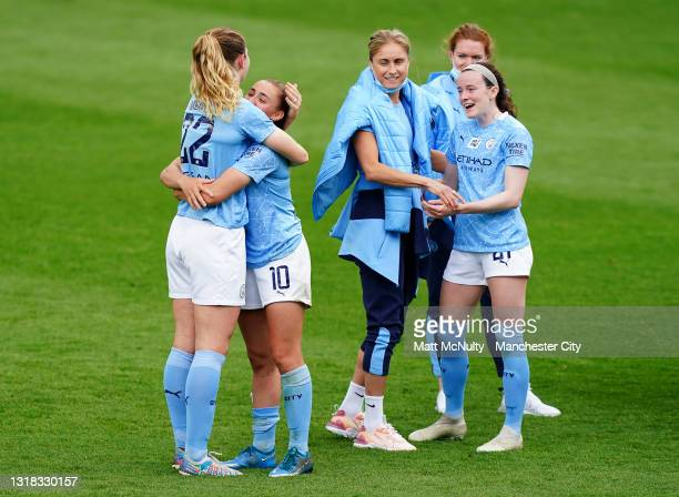 Georgia Stanway of Manchester City hugs teammate Sam Mewis during the FA Cup 5th Round match between Manchester City and West Ham United at...