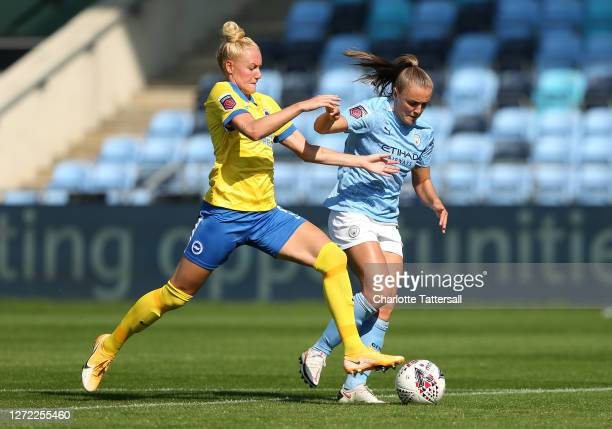 Georgia Stanway of Manchester City is challenged by Danique Kerkdijk of Brighton and Hove Albion during the FA Women's Super League at Manchester...