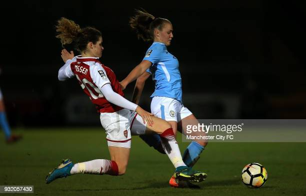 Georgia Stanway of Manchester City is tackled by Dominique Janssen of Arsenal during the WSL Continental Cup Final between Arsenal Women v Manchester...