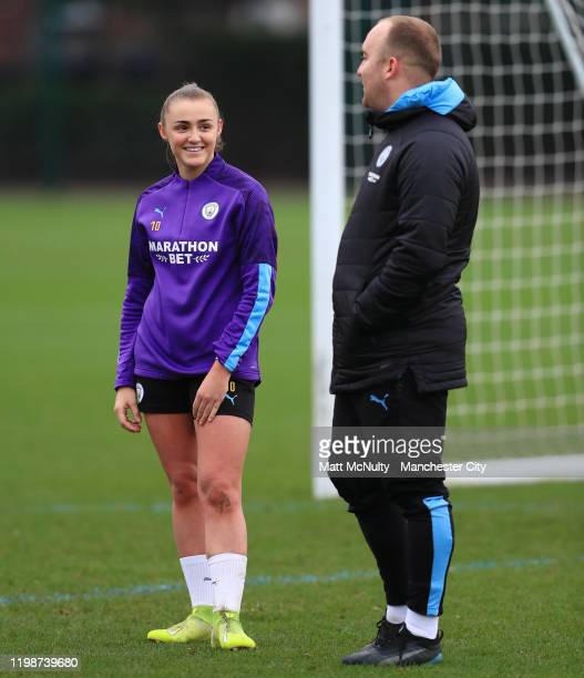 Georgia Stanway of Manchester City talks with Nick Cushing Manager of Manchester City during the training session at Manchester City Football Academy...
