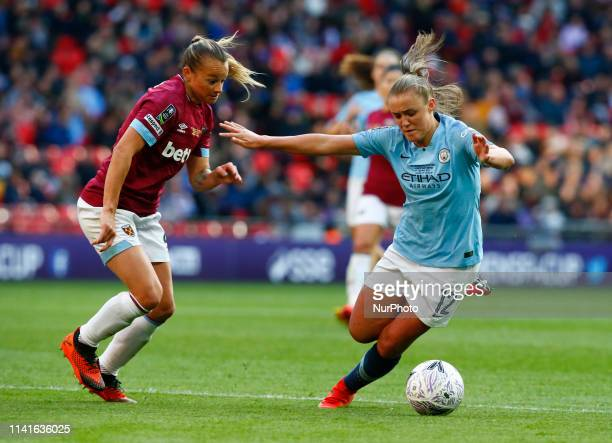 Georgia Stanway of Manchester City WFC takes on Ria Percival of West Ham United WFC during The SSE Women's FA Cup Final match between Manchester City...