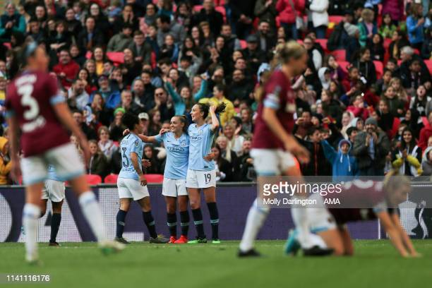 Georgia Stanway of Manchester City Women celebrates with team mates Demi Stokes of Manchester City Women and Caroline Weir of Manchester City Women...