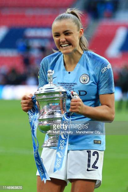 Georgia Stanway of Manchester City Women celebrates with the Women's FA Cup Trophy following her team's victory in the Women's FA Cup Final match...