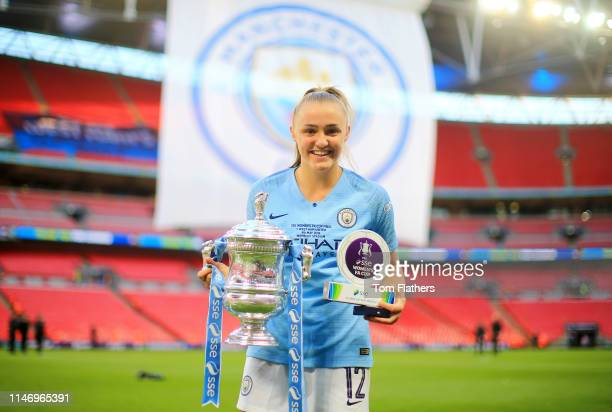 Georgia Stanway of Manchester City Women poses with her Player of the Match Award and the Women's FA Cup Trophy following her team's victory in the...