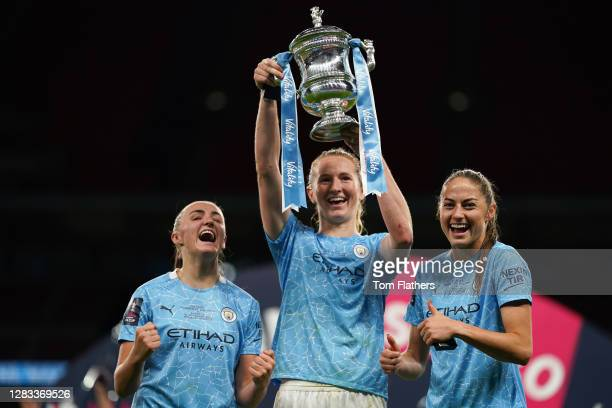 Georgia Stanway, Sam Mewis and Janine Beckie of Manchester City celebrate with the Vitality Women's FA Cup Trophy following their team's victory in...