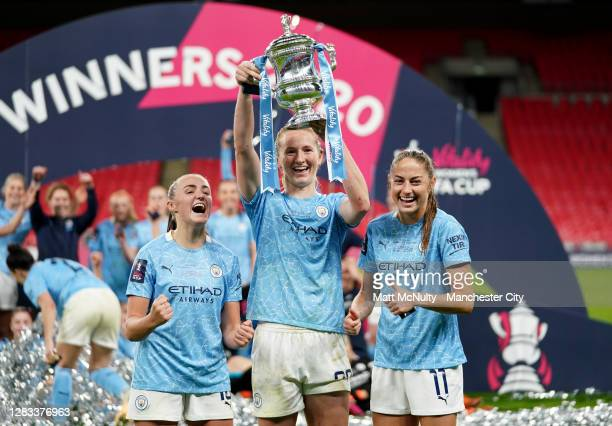 Georgia Stanway, Sam Mewis and Janine Beckie of Manchester City celebrate with the trophy during the Vitality Women's FA Cup Final match between...