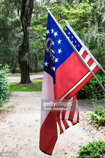 Georgia state flag and United States flag in front yard