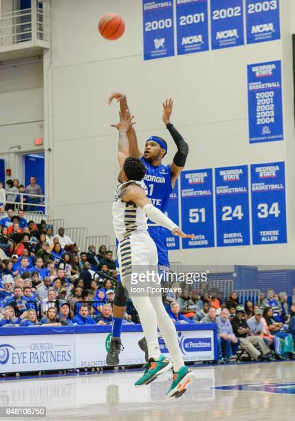 Georgia State Panther Jeremy Hollowell shoots a three pointer over a Georgia Southern Eagle defender in a Sun Belt Conference basketball game at the...