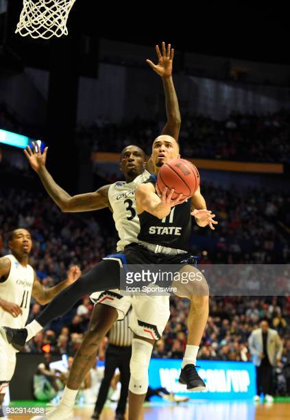Georgia State Panthers guard Isaiah Williams lays the ball up past Cincinnati Bearcats guard Justin Jenifer during the first half between the...