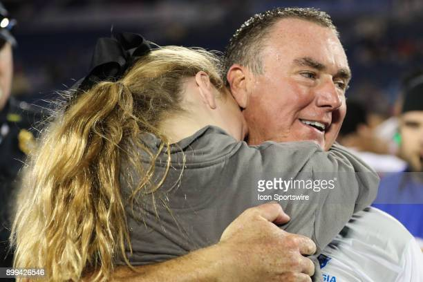 Georgia State Panthers head coach Shawn Elliott hugs his daughter after winning the Cure Bowl between the Western Kentucky Hilltoppers and the...