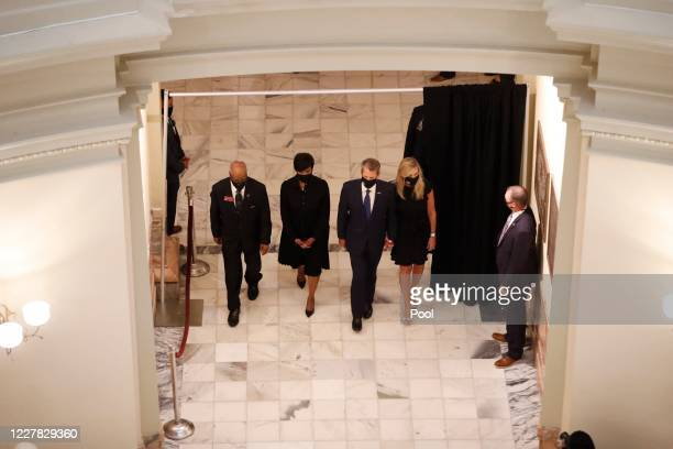 Georgia state Rep Calvin Smyre Atlanta Mayor Keisha Lance Bottoms Gov Brian Kemp and his wife Marty Kemp walk ahead of the casket as the late Rep...