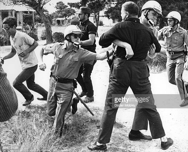 Georgia State Troopers were called in to avoid violence when blacks applied for admission to the all white school in August 1965 in Crawfordville...