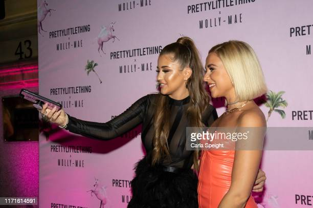 Georgia Steel and Gabby Allen attends the Pretty Little Thing X MollyMae party at Rosso on September 01 2019 in Manchester England