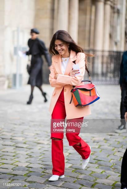 Georgia Tal is seen wearing red ripped pants Loewe bag outside Thom Browne during Paris Fashion Week Womenswear Fall/Winter 2019/2020 on March 03...
