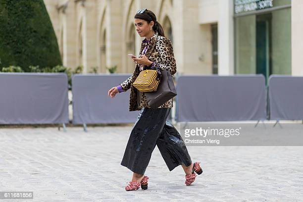 Georgia Tal wears leo print coat and latex pants outside of Dior on September 30 2016 in Paris France