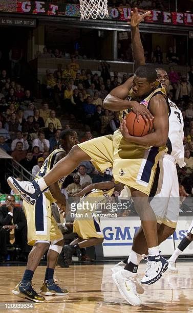 Georgia Tech center Alade Aminu rips down a rebound in front of Wake Forest forward Eric Williams during first half action at the LJVM Coliseum in...