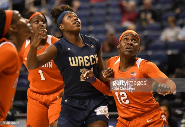 Georgia Tech Yellow Jackets forward Zaire O'Neil and Clemson Lady Tigers guard Aliyah Collier battle for position on a rebound during the ACC women's...