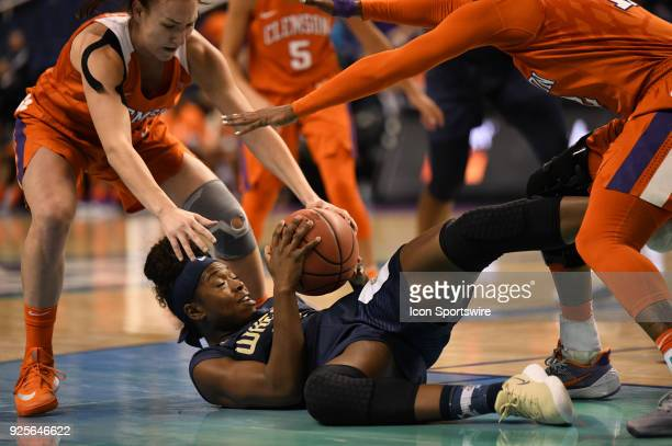 Georgia Tech Yellow Jackets guard Chanin Scott grabs the ball on the floor during the ACC women's tournament game between the Clemson Tigers and...