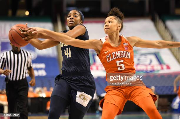 Georgia Tech Yellow Jackets guard Kierra Fletcher chases down a loose ball with Clemson Lady Tigers guard Danielle Edwards following during the ACC...