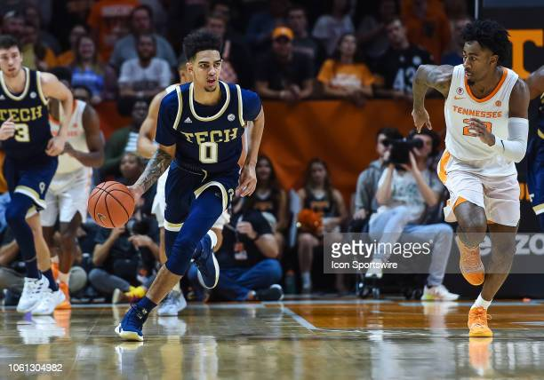 Georgia Tech Yellow Jackets guard Michael Devoe pushes the ball up the court as he is chased by Tennessee Volunteers guard Jordan Bowden during a...