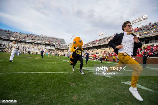 Georgia Tech Yellow Jackets mascot Buzz and fans storm the field at the conclusion of the Georgia Bulldogs v Georgia Tech Yellow Jackets game on...