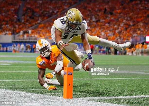 Georgia Tech Yellow Jackets quarterback TaQuon Marshall dives in for a touchdown as Tennessee Volunteers defensive back Rashaan Gaulden defends...