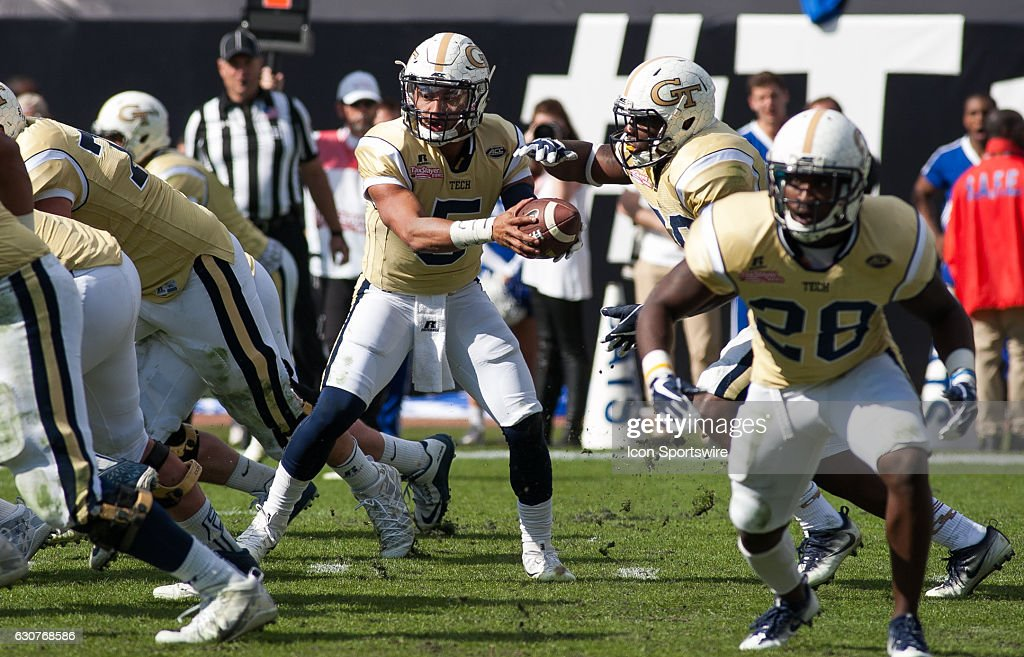 Georgia Tech Yellowjackets quarterback Justin Thomas (5) hands off the ball during the TaxSlayer Bowl game between the Georgia Tech Yellowjackets and the University of Kentucky Wildcats on December 31, 2016, at EverBank Field in Jacksonville, FL.