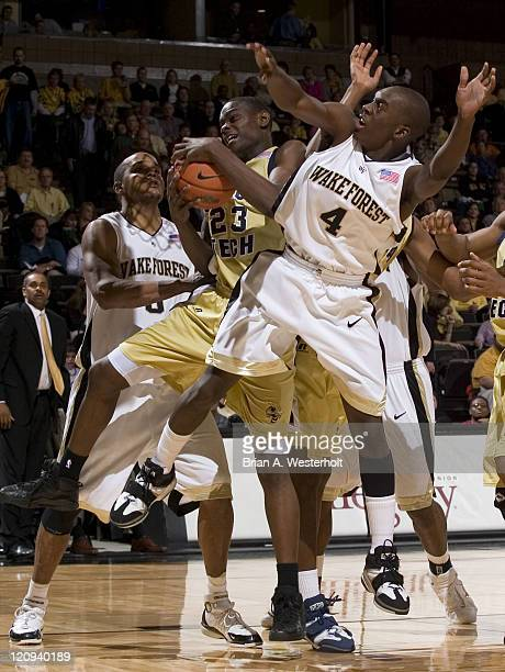 Georgia Tech's Anthony Morrow grabs a rebound between Wake Forest's Harvey Hale and Chris Ellis during second half action at the LJVM Coliseum in...