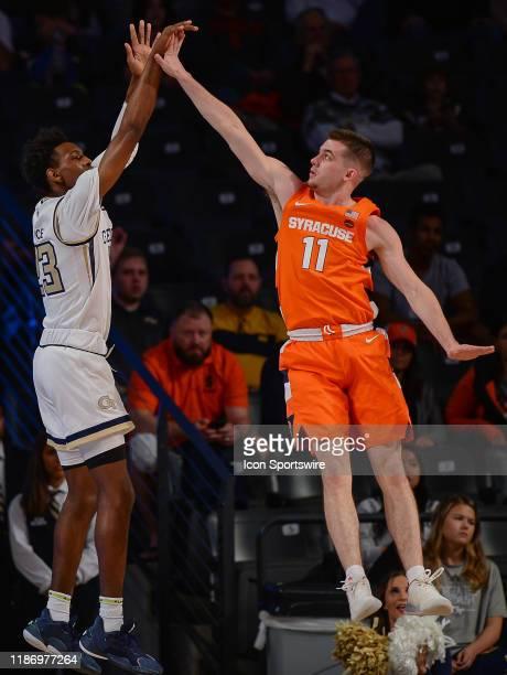 Georgia Tech's Asanti Price shoots over Syracuse's Joseph Girard III during the NCAA basketball game between the Syracuse Orange and the Georgia Tech...