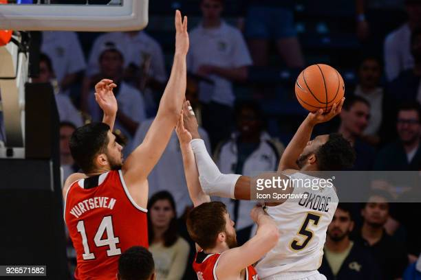 Georgia Techs Josh Okogie shoots over North Carolina State's Omer Yurtseven during the game between North Carolina State and Georgia Tech on March 1...