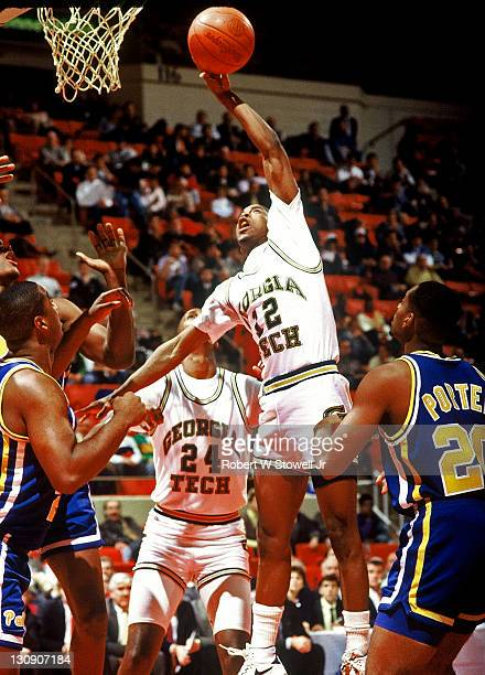 Georgia Tech's star point guard Kenny Anderson goes high for a rebound against the University of Pittsburgh in a game pitting the Atlantic Coast...